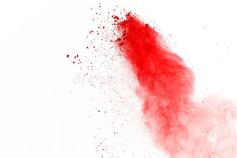 Abstract of red powder explosion on white background. Red powder splatted isolate. Colored cloud. Colored dust explode. Paint Holi stock photo