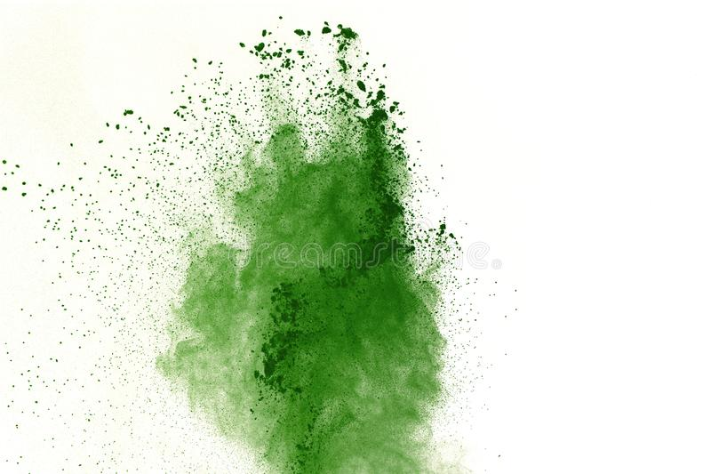 Abstract Red powder splatted background,Freeze motion of red powder exploding/throwing green dust. royalty free stock photo