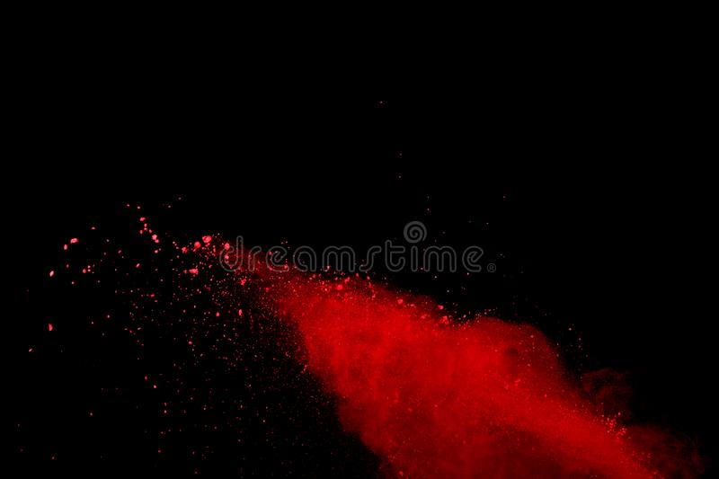 Abstract Red powder splatted background,Freeze motion of red powder exploding/throwing green dust.  royalty free stock photos