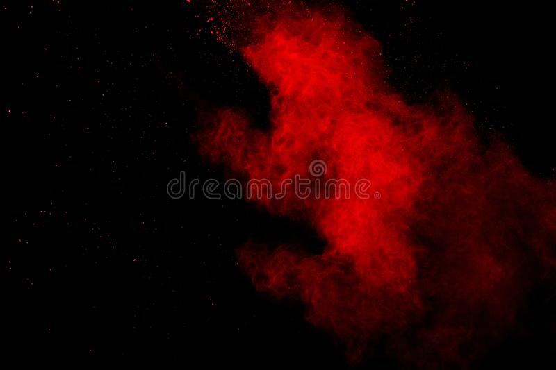 Abstract Red powder splatted background,Freeze motion of red powder exploding/throwing green dust.  stock photography
