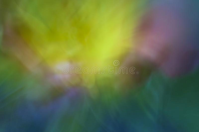 Abstract red  purple blue, yellow, tulip flowers in a dreamlike colorful impressionist photo. Abstract dreamlike purple yellow and blue tulips royalty free stock photo
