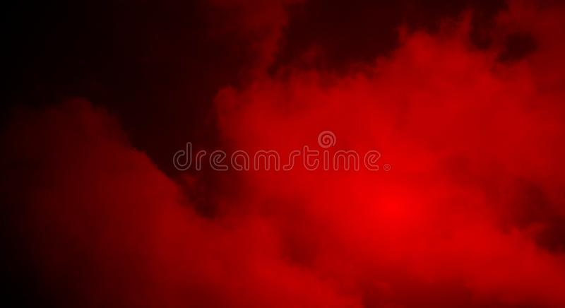 Abstract red smoke mist fog on a black background wallpaper. Many uses for advertising, book page, paintings, printing, mobile wallpaper, mobile backgrounds royalty free stock photos
