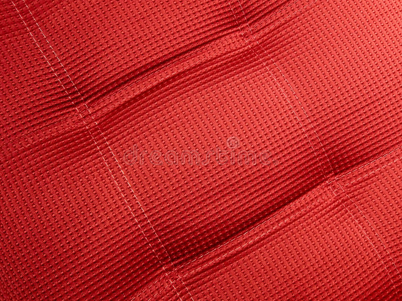 Abstract red textile background closeup, cloth, stock photo