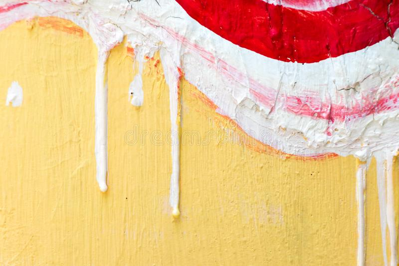 Abstract red, white and yellow paint on concrete background stock photo