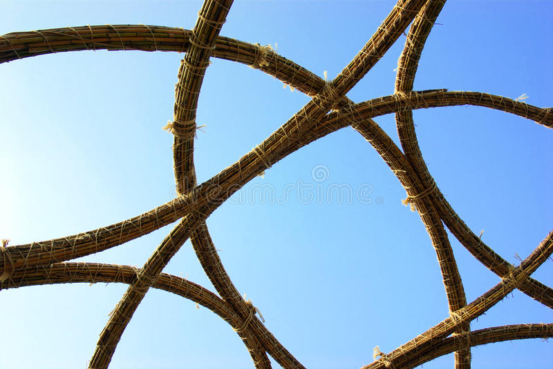Abstract Reeds. Abstract structure built with reeds and rope against blue sky royalty free stock photos