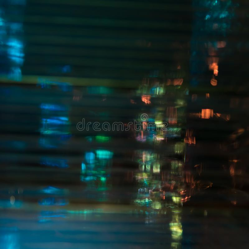 The abstract reflection of the city in the night. The abstract reflection of the city in the deep night royalty free stock photo