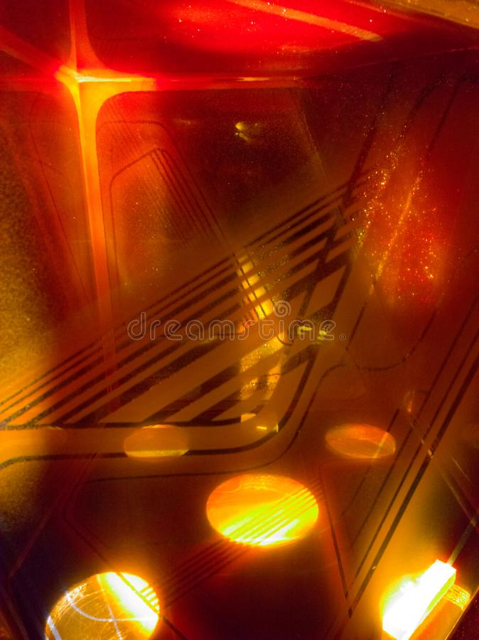 Abstract Reflections. Brilliant orange light shining and reflecting through multiple layers of glass royalty free stock images