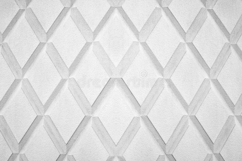 Abstract rhombus shape white and black color background close up, gray concrete wall with diamond texture pattern, rhomb ornament royalty free stock photos