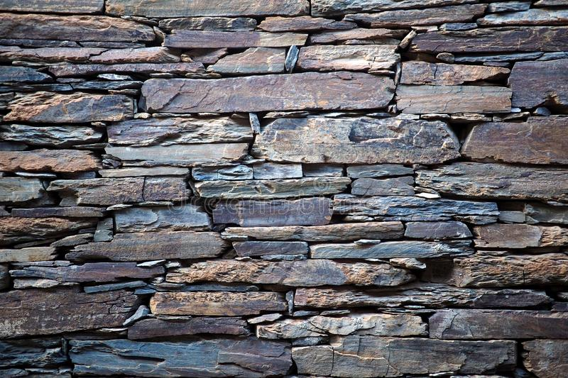 Abstract rock wall detail, stonework royalty free stock photos