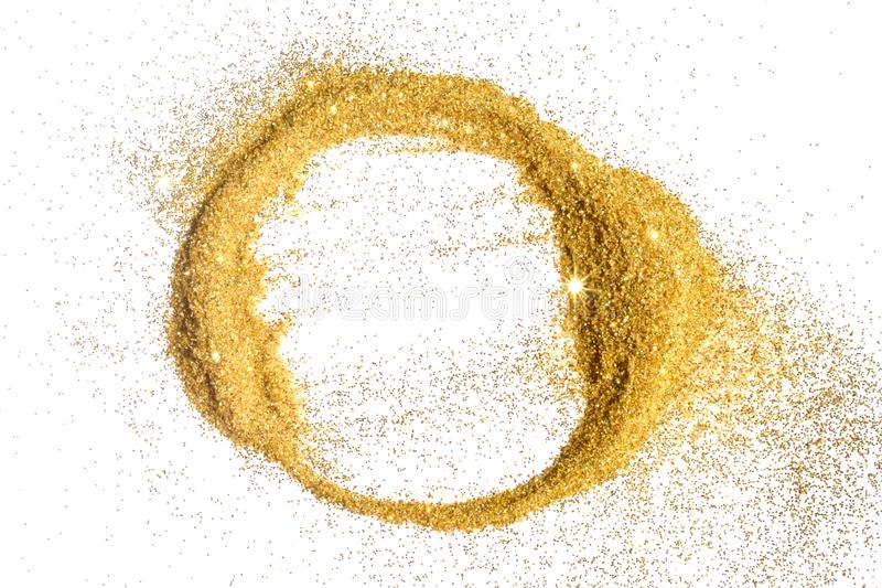 Abstract round frame of golden glitter sparkle on white. Textured background with border for your design.  stock photography