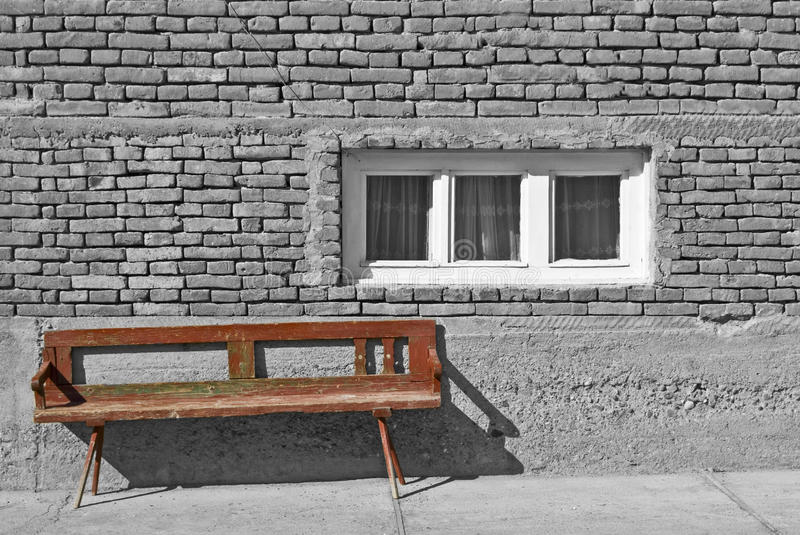 Abstract rural picture. Abstract black and white picture of a house with small windows. Depressing picture stock photography
