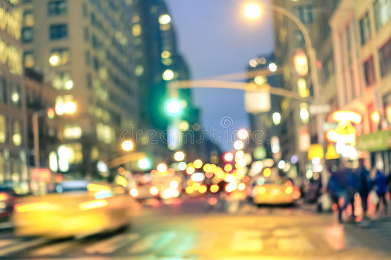 Abstract rush hour and traffic jam in New York City. New york City abstract rush hour - Defocused yellow taxi cabs and traffic jam on 5th avenue in Manhattan royalty free stock photography