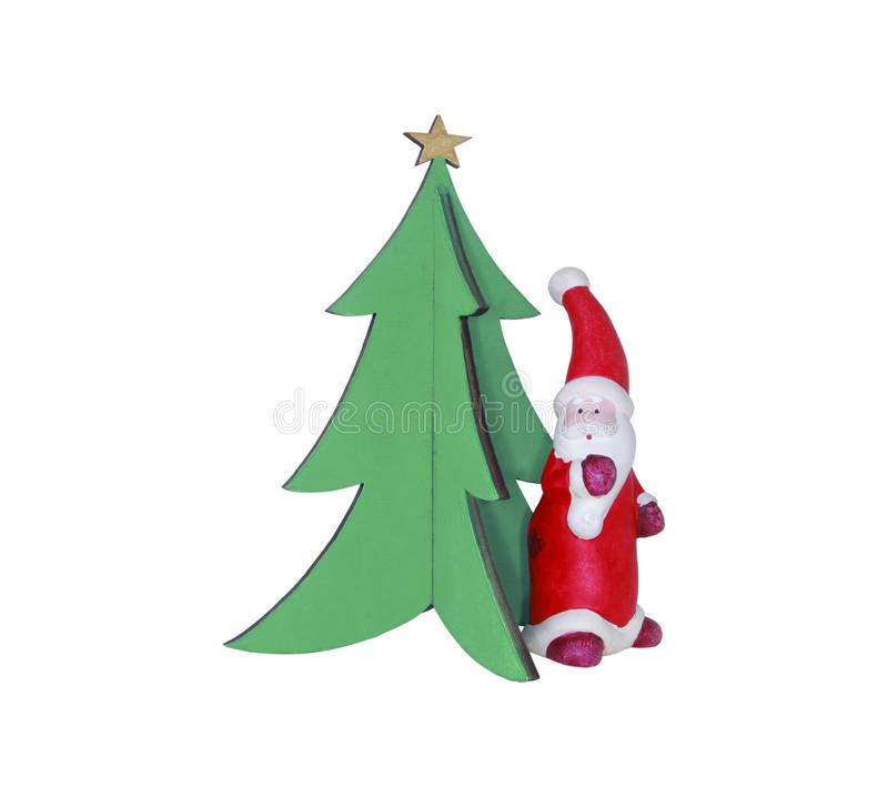 Abstract Santa Claus standing by Christmas tree isolated on white. Christmas/New Year concept. Christmas backgrounds royalty free stock photography