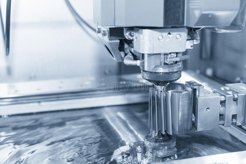 Abstract scene of close-up of the wire - EDM CNC machine stock image