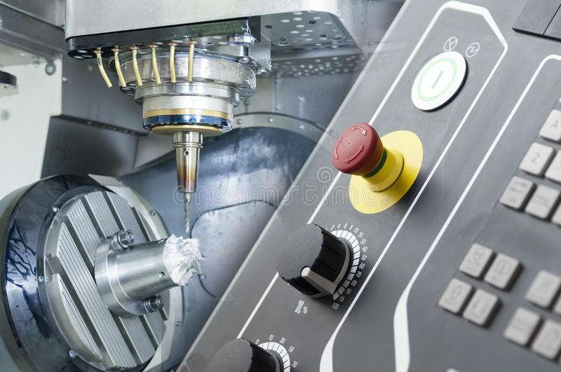 Abstract scene of the five axis CNC machine. With the raw material work piece and the CNC`s controller panel royalty free stock photos