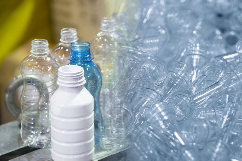 The abstract scene of preform shape and  plastic bottles product. royalty free stock photography
