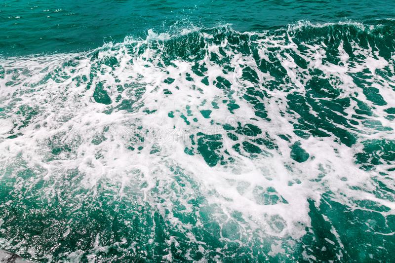 Abstract sea wave background. Deep aqua water surface and white foam texture stock image