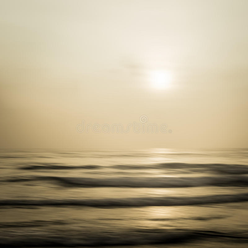Abstract seascape with blurred panning motion background. Abstract seascape with blurred panning motion in warm tone background royalty free stock photo