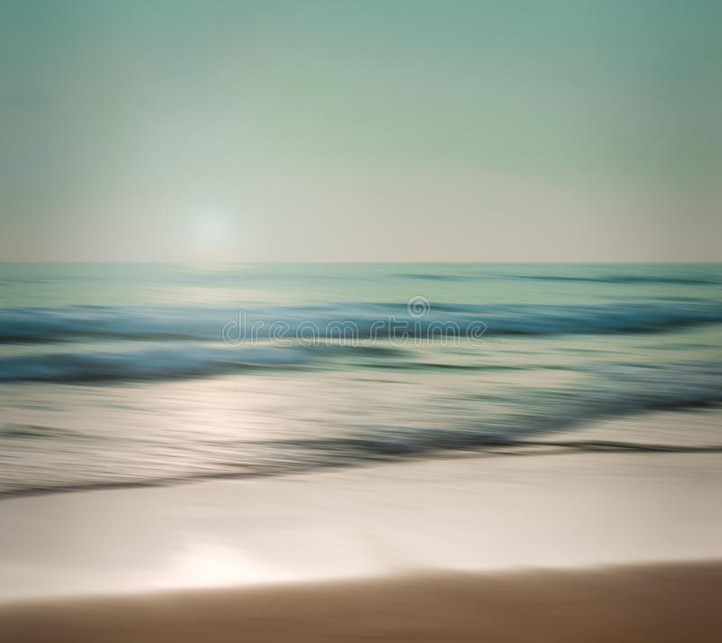 An abstract seascape with blurred panning motion on paper background. An abstract seascape with blurred panning motion with cross-processed colors on paper stock images