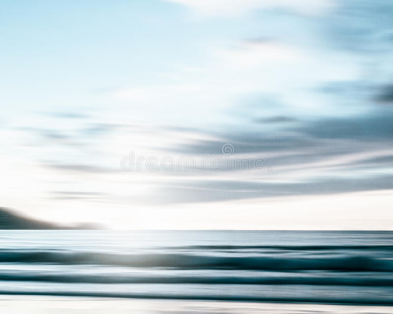 An abstract seascape with blurred panning motion on paper background. An abstract seascape with blurred panning motion with cross-processed colors on paper stock photos