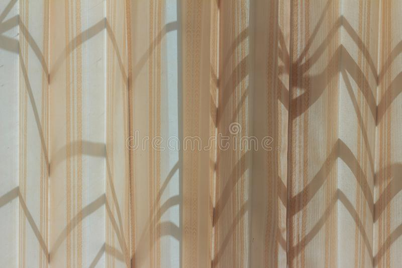 Abstract shadow of steel cage appeared on the curtain on the win stock photos