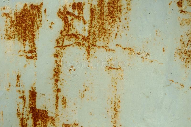 Abstract shapes of rust streaks on a painted metal royalty free stock image