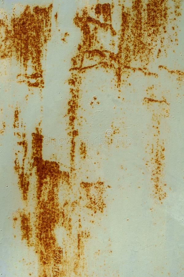 Abstract shapes of rust streaks on a painted metal royalty free stock photography