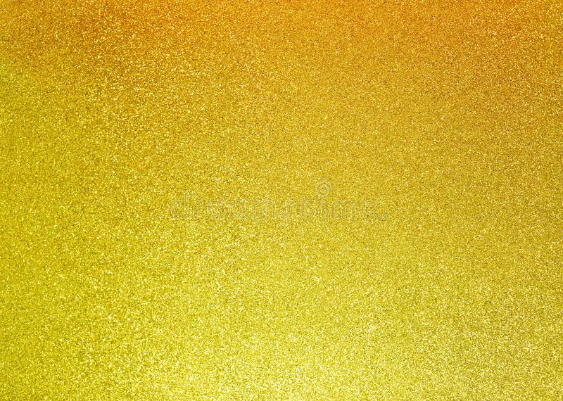 Abstract shimmering christmas background with golden light shine glitter texture royalty free stock photo