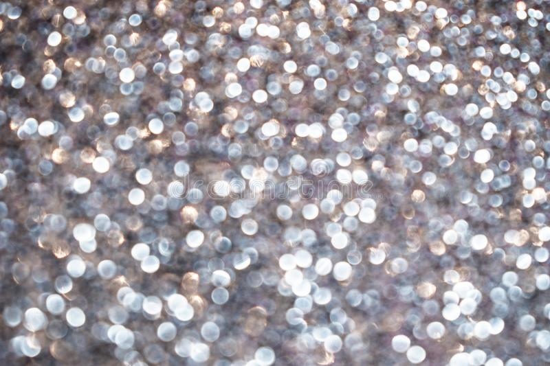 Abstract shiny silver glitter sparkle background. Metallic texture, selective focus royalty free stock photography
