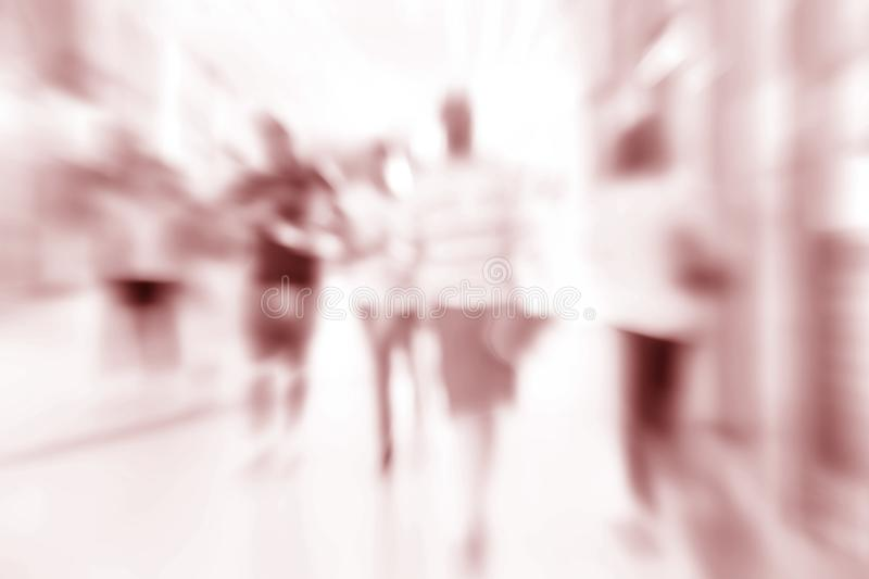Abstract shopping in mall store blurred background. Radial blur abstract shopping in mall store blurred background. pink color royalty free stock photography