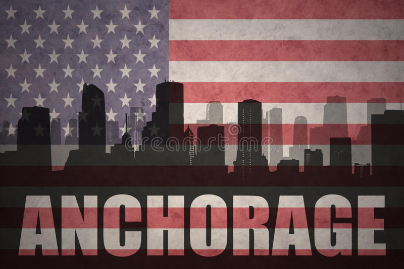 Abstract silhouet van de stad met tekst Anchorage bij de uitstekende Amerikaanse vlag royalty-vrije stock foto