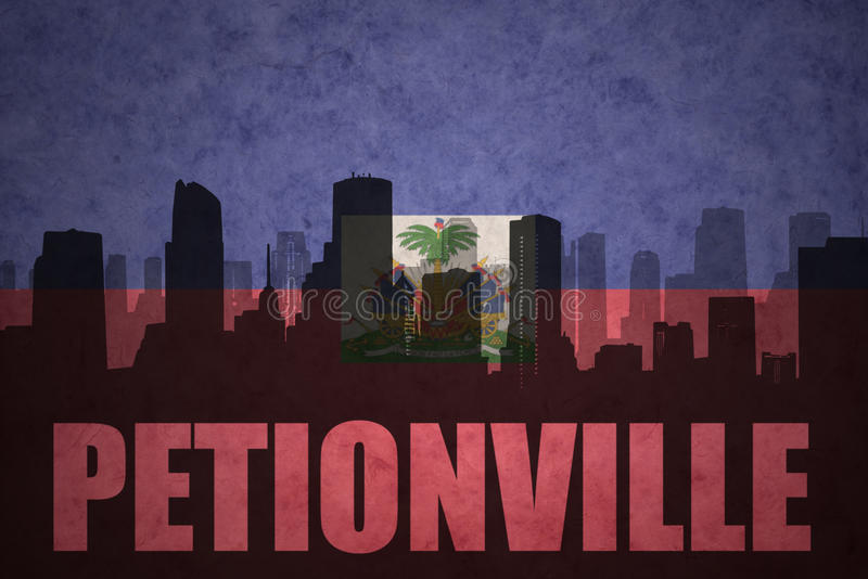 Abstract silhouet van de stad met tekst Petionville bij de uitstekende haitian vlag stock foto's