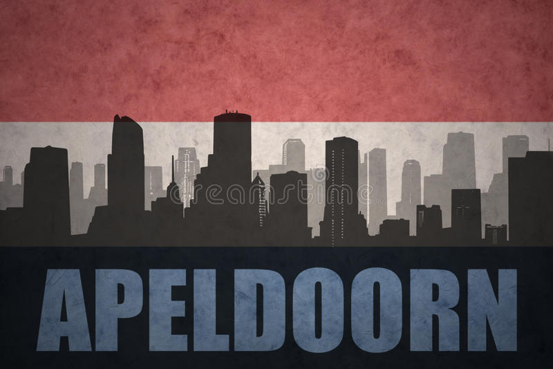Abstract silhouette of the city with text Apeldoorn at the vintage dutch flag. Background stock photography