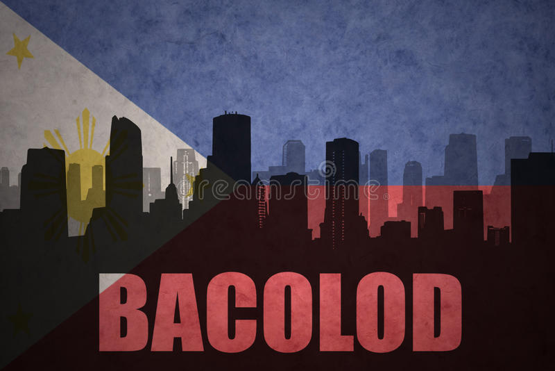 Abstract silhouette of the city with text Bacolod at the vintage philippines flag. Background stock photos