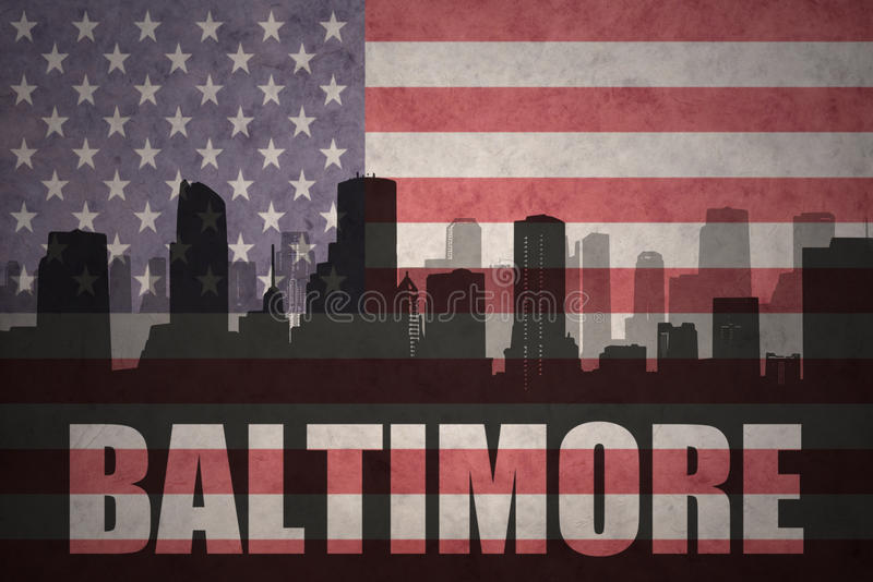 Abstract silhouette of the city with text Baltimore at the vintage american flag. Background stock photo