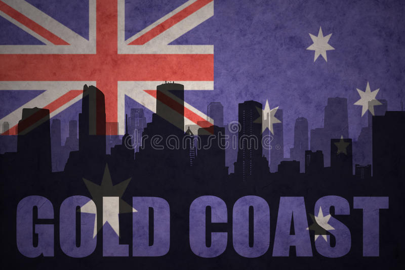 abstract silhouette of the city with text Gold Coast at the vintage australian flag stock illustration