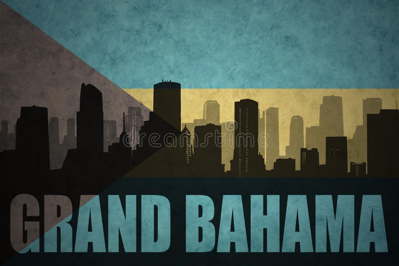 Abstract silhouette of the city with text Grand Bahama at the vintage bahamas flag. Background vector illustration