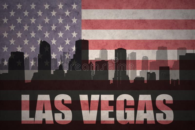 Abstract silhouette of the city with text Las Vegas at the vintage american flag royalty free illustration