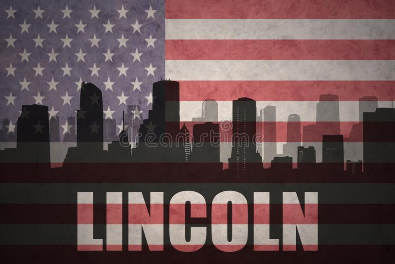 Abstract silhouette of the city with text Lincoln at the vintage american flag stock image