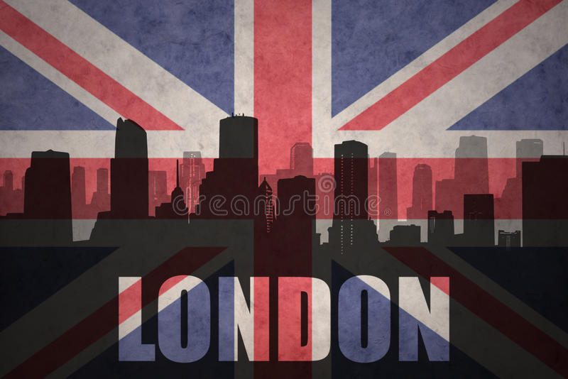 Abstract silhouette of the city with text London at the vintage british flag royalty free stock photography