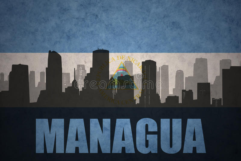Abstract silhouette of the city with text Managua at the vintage nicaraguan flag royalty free illustration