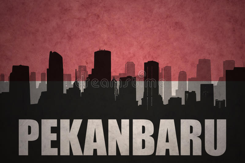 Abstract silhouette of the city with text Pekanbaru at the vintage indonesian flag. Background stock image