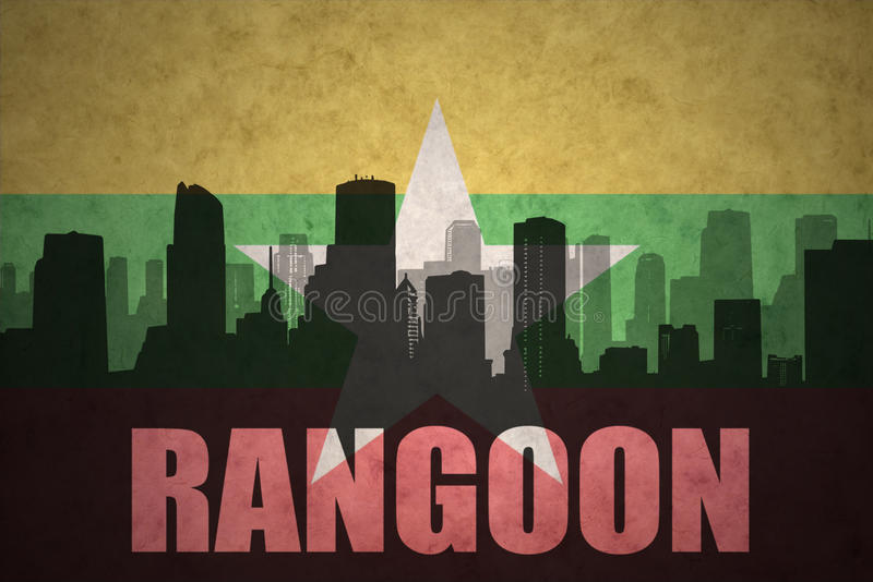abstract silhouette of the city with text Rangoon at the vintage myanmar flag royalty free illustration