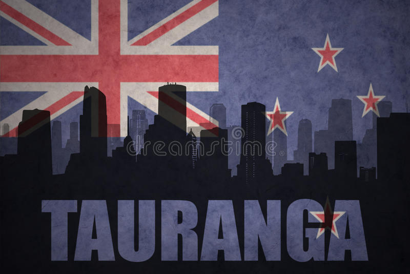 Abstract silhouette of the city with text Tauranga at the vintage new zealand flag. Background royalty free stock images