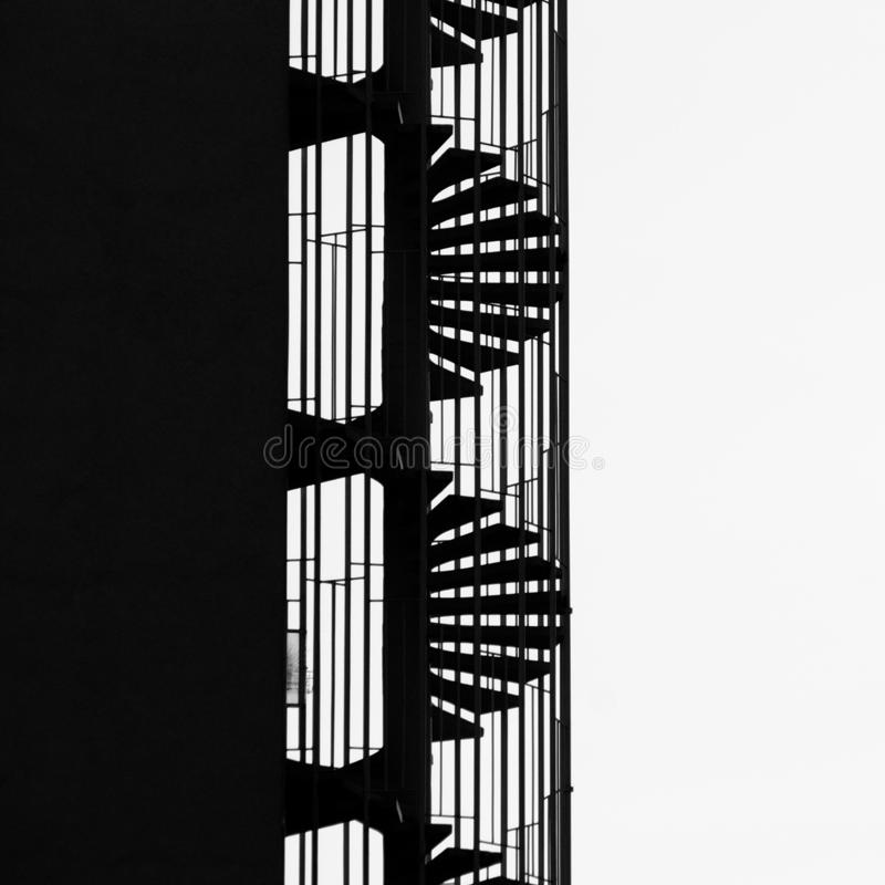 Abstract Silhouette Of Fire Stairs. Abstract black and white detail of silhouette of fire stairs on high apartement block stock images