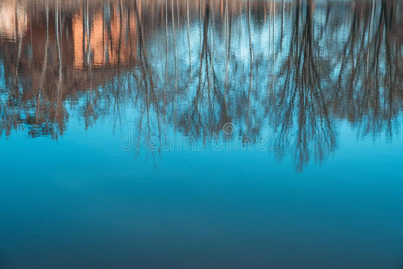 Abstract Silhouettes Reflection in the water. .House and trees . Artistic Nature Background stock photo