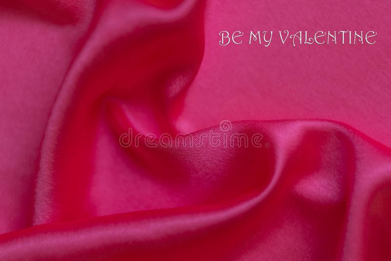 Abstract background, rippled pink silk and romantic text royalty free stock image