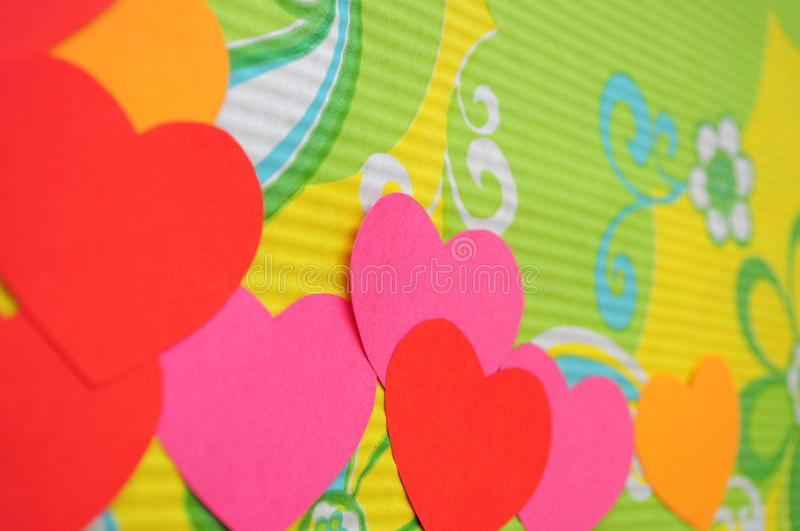 Abstract simple love heart background. Paper cutout. Colorful Cartoon hearts royalty free stock photos