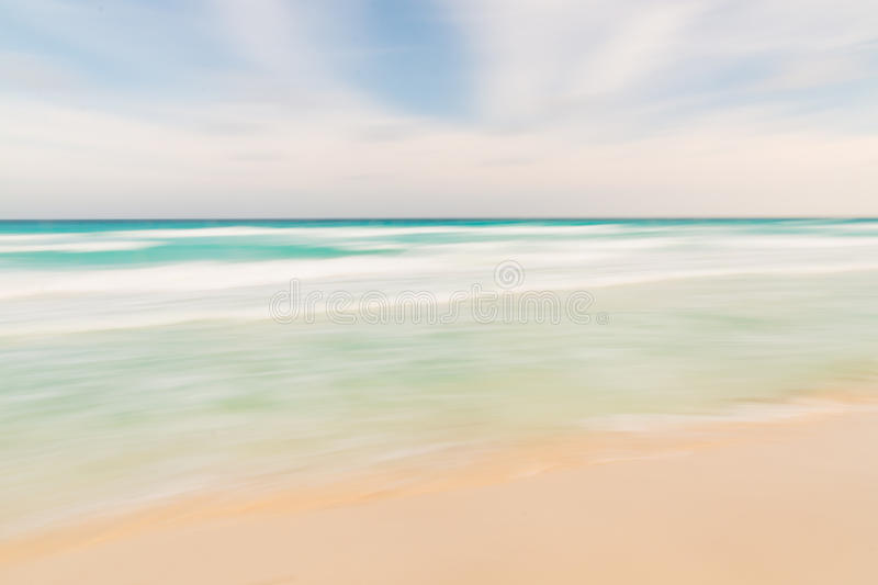 Abstract sky, ocean and beach nature background with blurred pan royalty free stock image