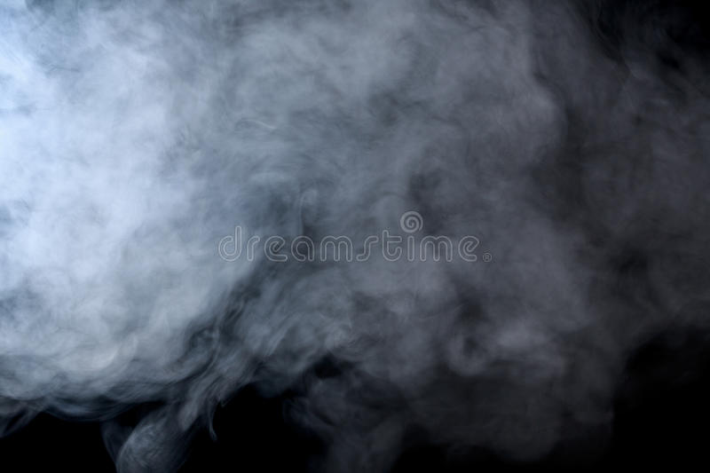 Abstract smoke hookah on a black background. Abstract smoke on a black background. Texture. Design element. Abstract art. Smoke from hookah. Macro shooting stock images